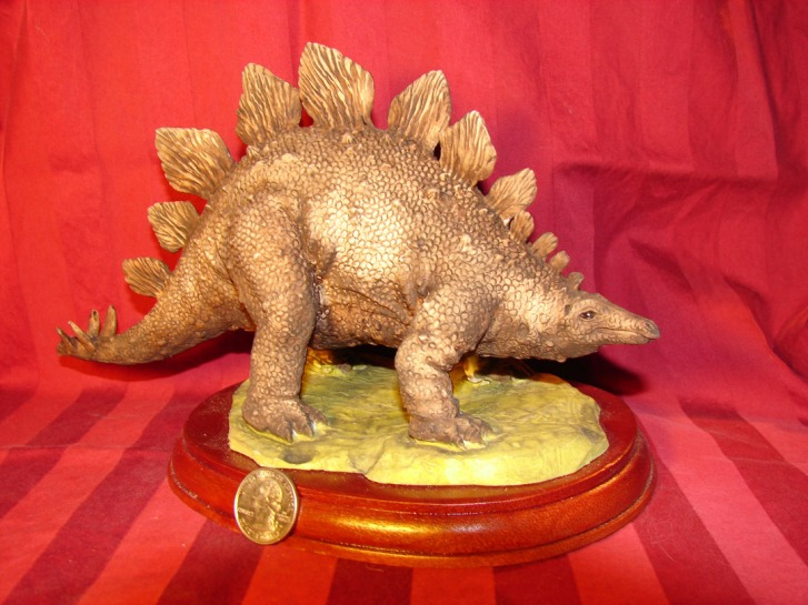 A Stegosaurus statuette.